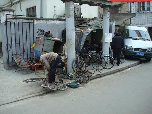 Réparateur vélo en Chine